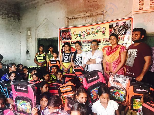 Bags distribution to the village kids to encoauge them to go to school