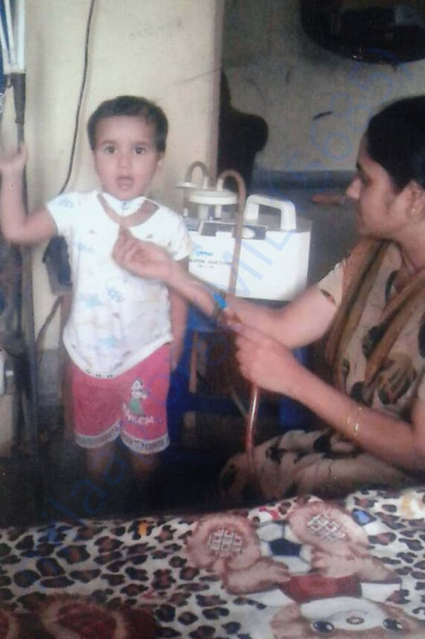 Removing secretions image of patient S. Jathin Raj and his mon saritha