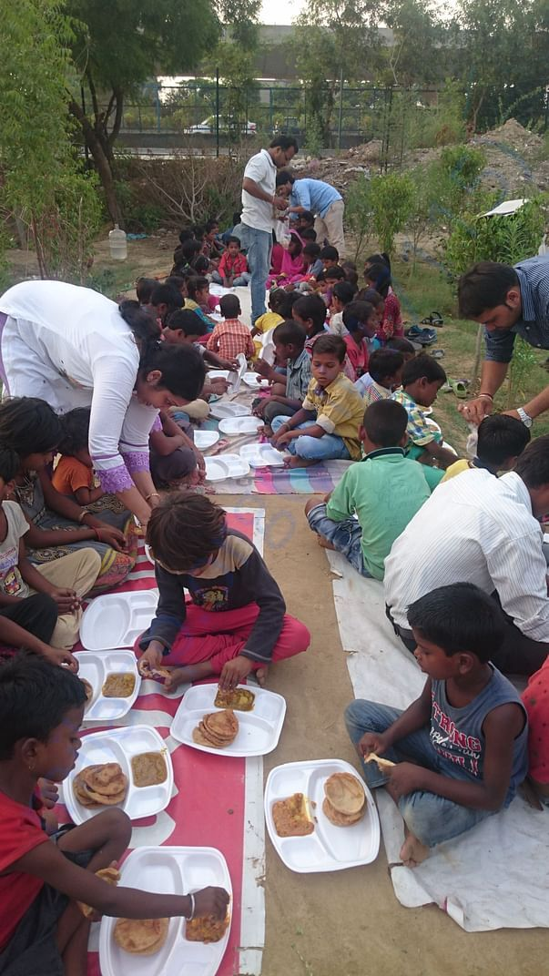 team providing food to our students