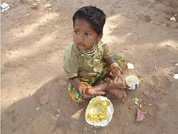 Feed a nutritious meal to a hungry street child on the street/Slum