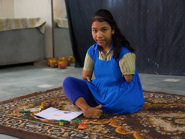 Meet the incredible 12-year-old girl born without arms and one leg