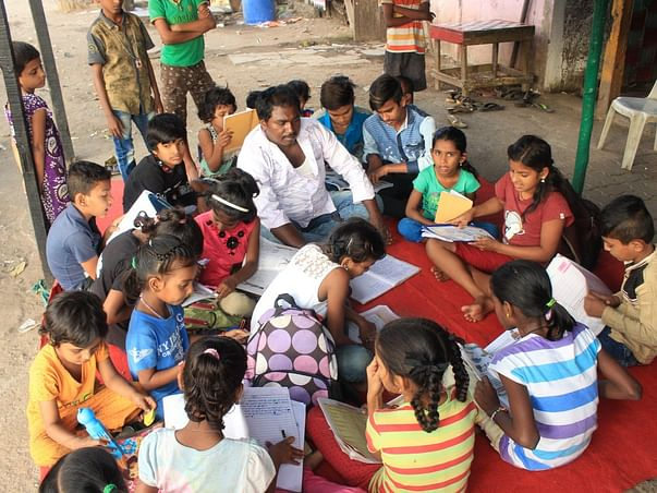 Building free traning centre in slum area for kids & womens