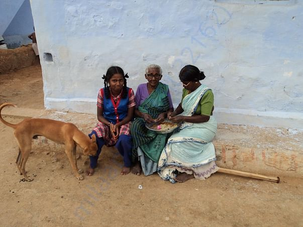 Kowsalya assisting her mother and grandmother in Beedi rolling
