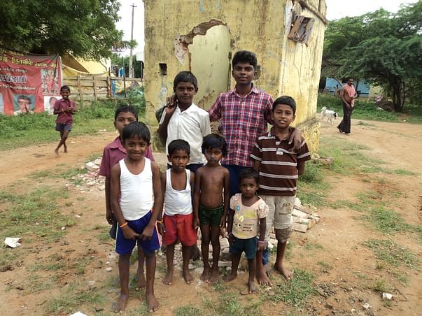 Student hanging out with his friends in the village