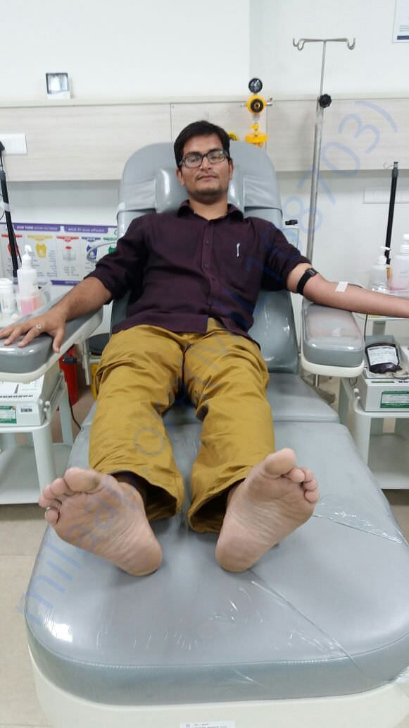 Friends donating blood