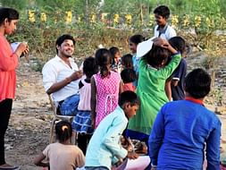 Help 195 slum area children studying roadside in open area school...