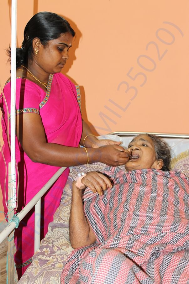 Spoon Feeding to inmate at our Destitute Welfare Center