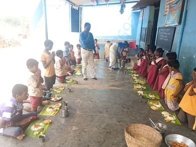 CHILDREN HAVING FOOD