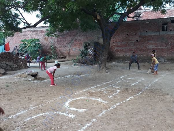 Girls practicing and learning Cricket