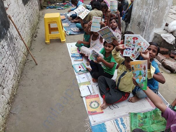 Children showing books