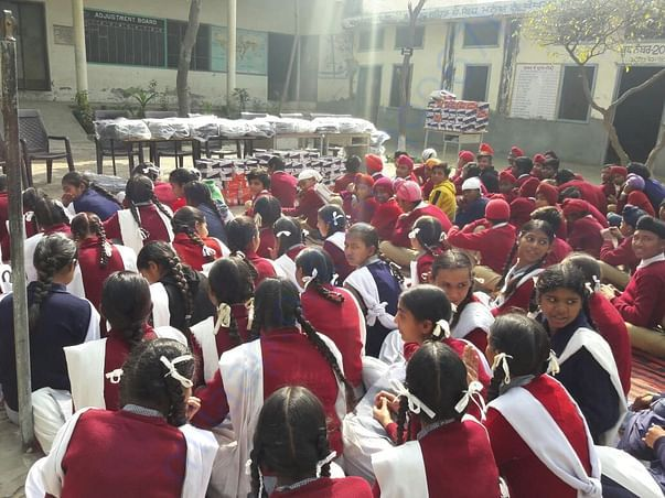 Provided 100 shoes and 100 school bags in govt. school in jagdev kalan