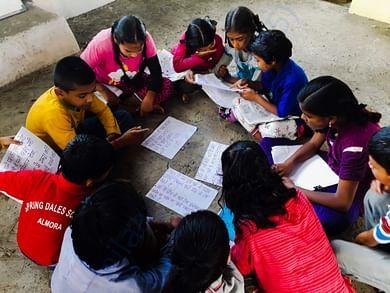Children brainstorming solutions for water shortage in their village