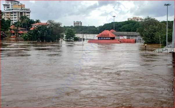Aluva Mahadeva Temple is seen submerged in the water following a flash