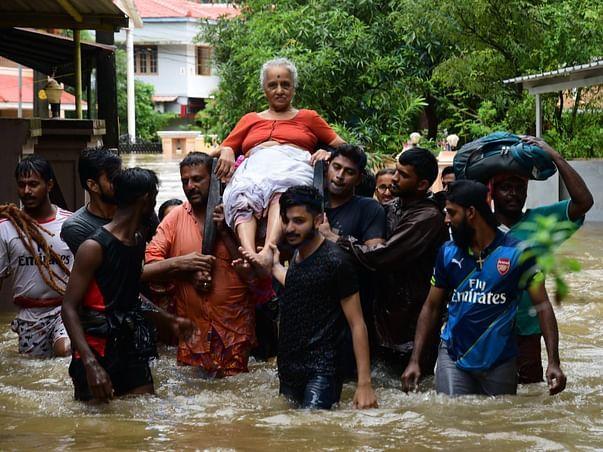 An elderly woman is rescued following a flash flood