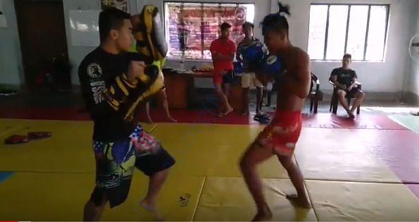 His padding during Muaythai and MMA seminar in Agartala