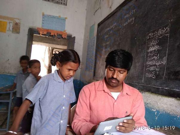 Volunteer conducting verbal early grade reading test
