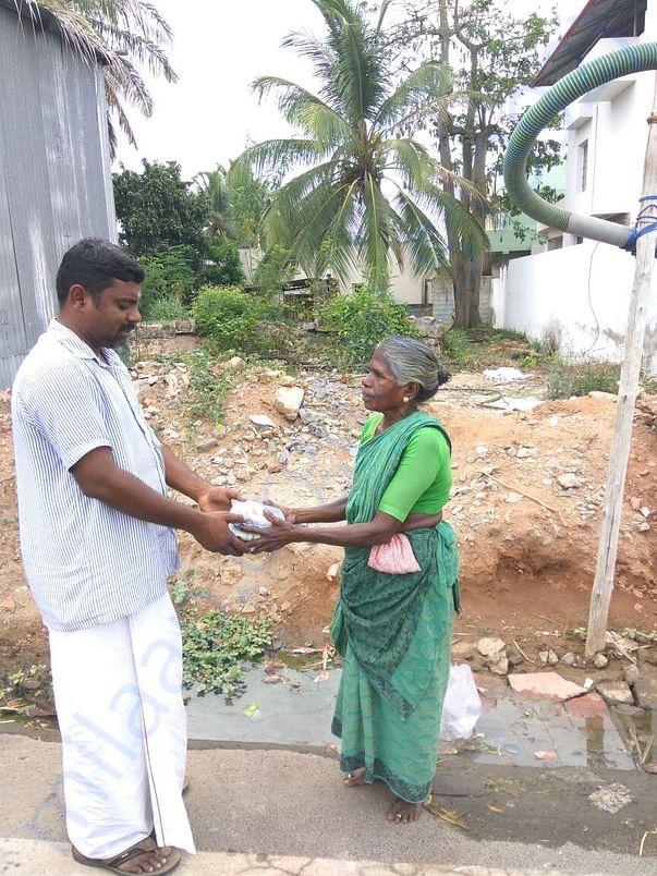 Sukumar distributing food packet