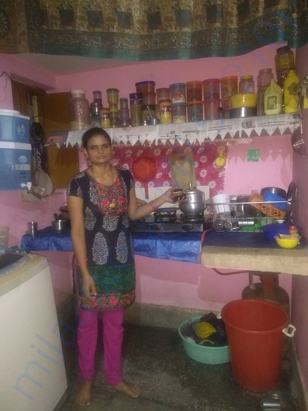 Rekha Devi in her house, working and rearing her three children