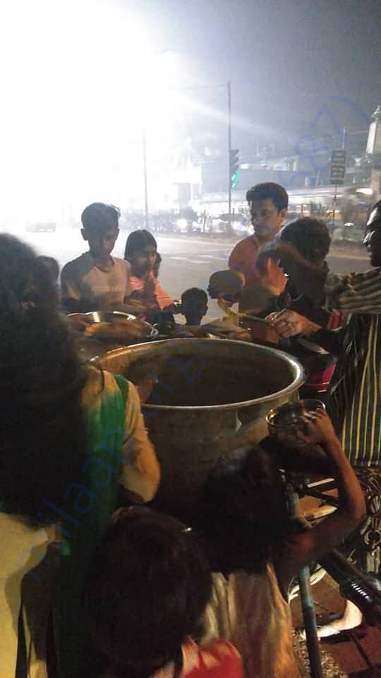 Indranil Banerjee feeding the street children of Dunlop