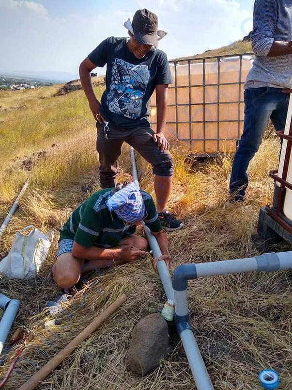 Installing drip irrigation system