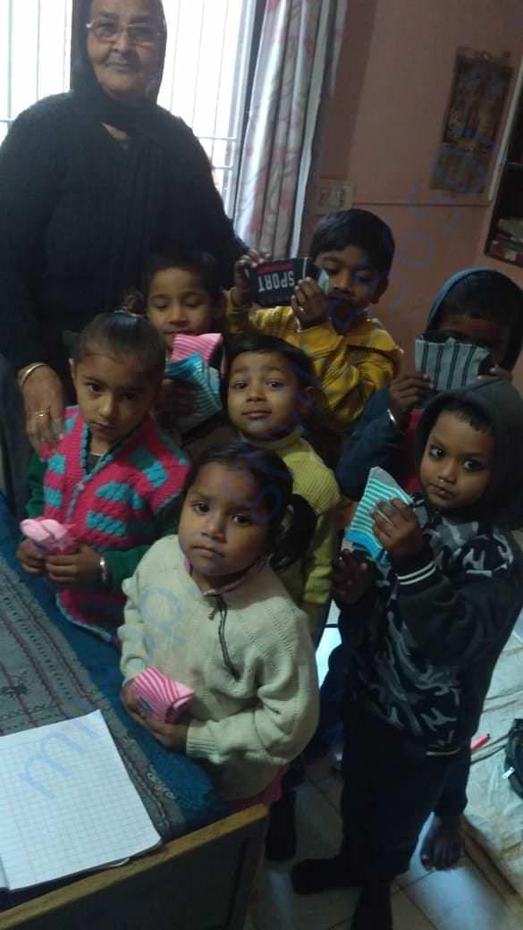 distributing pair of socks among the children