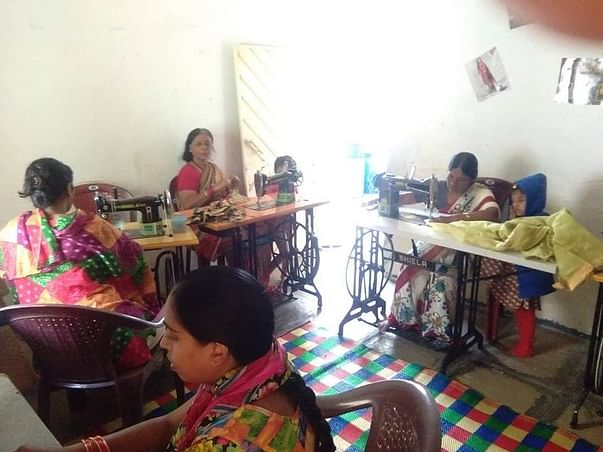 Support 40 House Wives with Sewing Machines