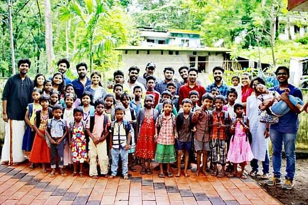 DISTRIBUTION OF SCHOOL KITS FOR TRIBAL CHILDREN AT THRISSUR