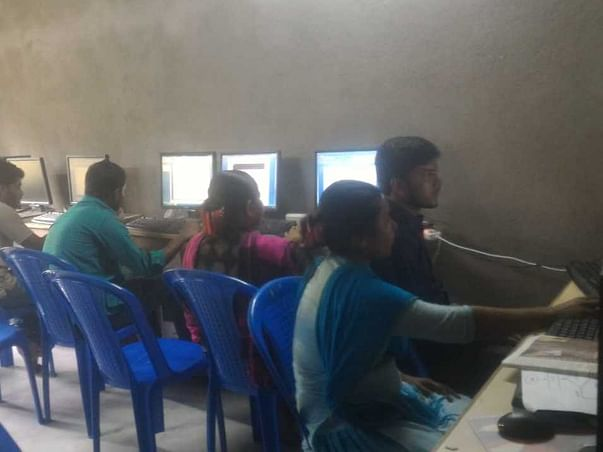 Help a computer training center for the education of students!