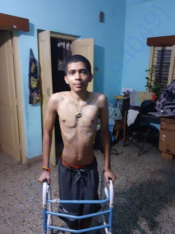 Photo of him unable to stand and walk