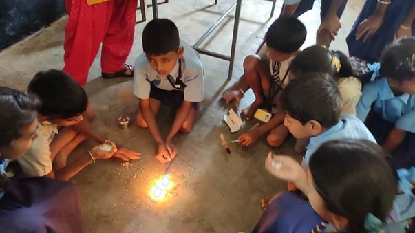students doing experiments with aspiring mind