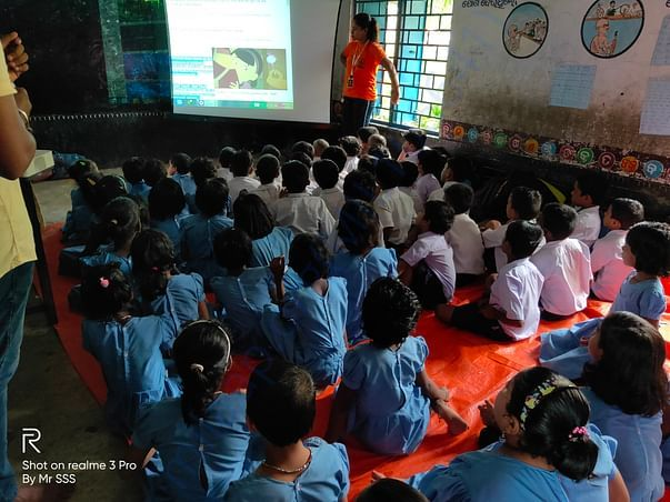 Showing a video clip on Good touch and bad touch to students