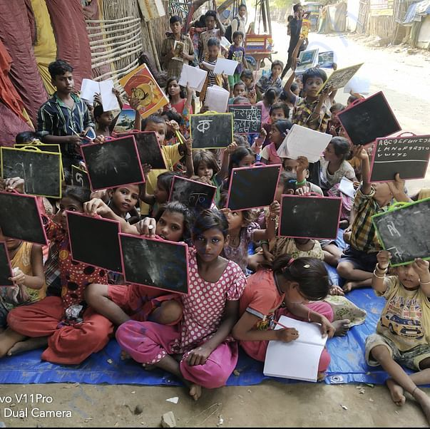 Childrens are happy after getting stationary in slum area
