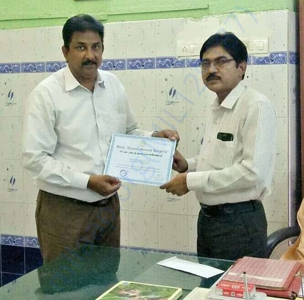 Receving Certificate of Appreciation from Givernment Hospital
