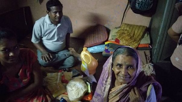 A poor family in Chembur recieves Ration packet through MIWF