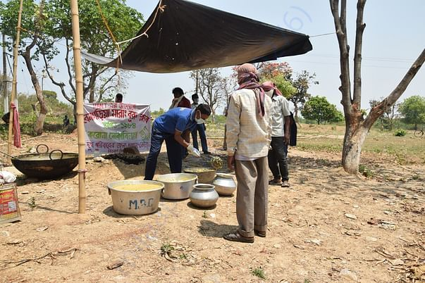 MANT volunteers preparing food for poor Santhali tribals