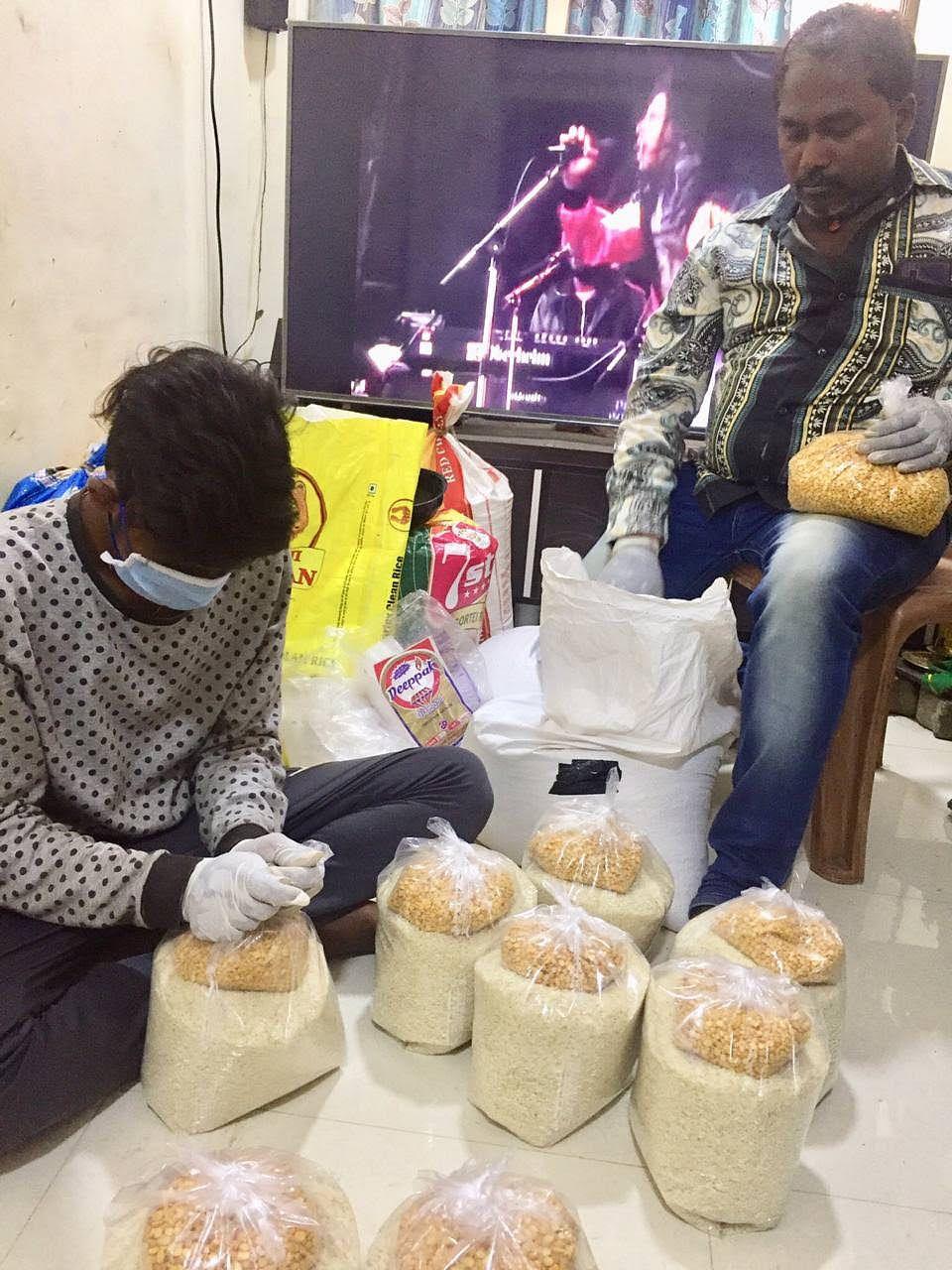 Our volunteers preparing ration kits