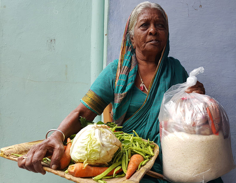 Donating monthly groceries to poor oldagewoman in india helpage person