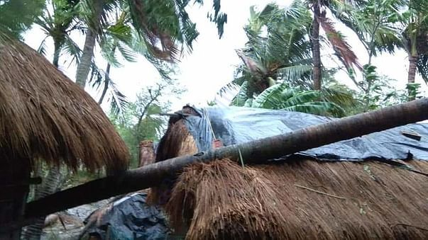 Large scale damage to property with several thatched houses uprooted