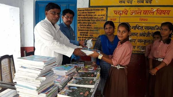 Helping the children in rural area by giving them books.