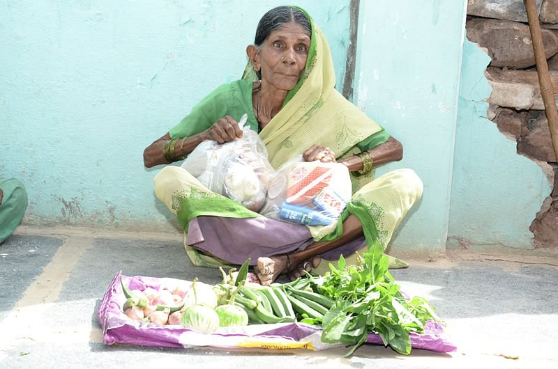 Oldage woman receiving food provisions adopt a granny