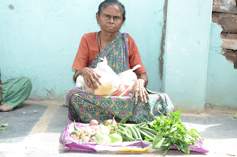 Poor senior citizen getting food provisions in india
