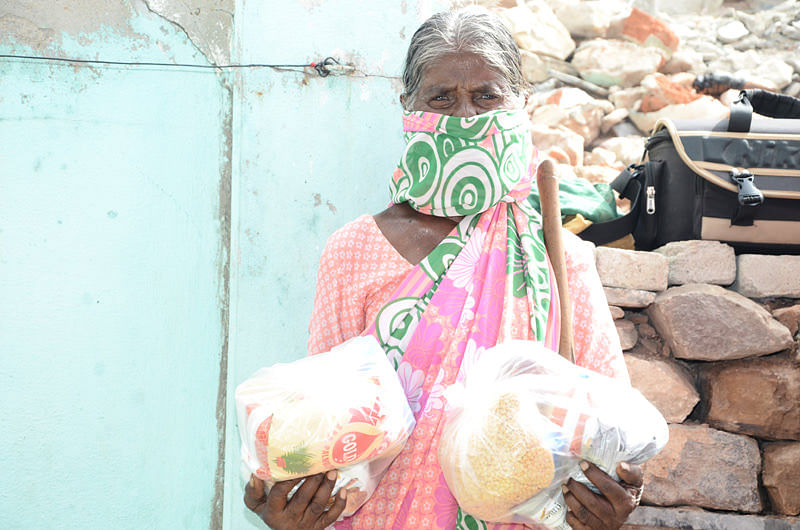 Sponsoring poor oldage woman with monthly groceries