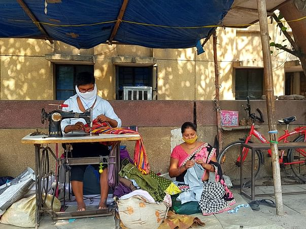 Help this roadside tailor educate his daughters