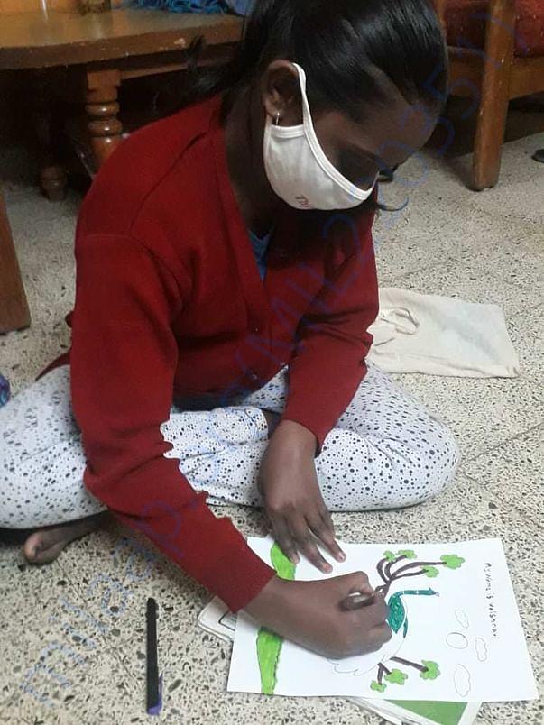 Vaishnavi doing her art work :)