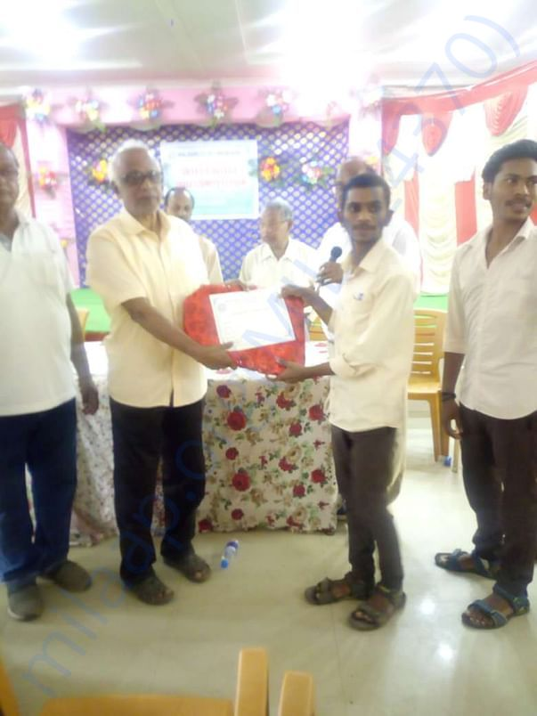 The sponsored youth is receiving recognition for excellent performance