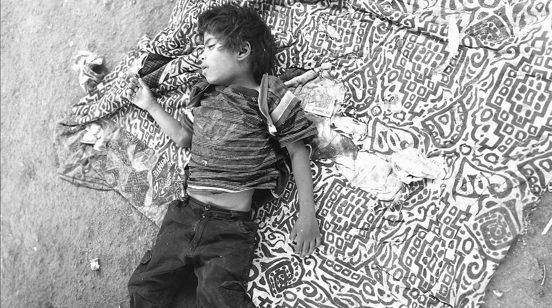 Sleeping kid on street