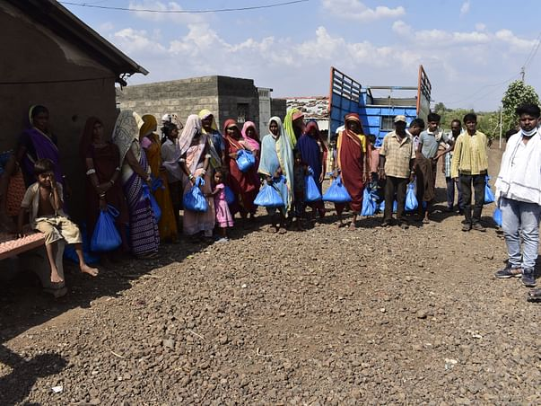 Distribution of ration-kit to poor tribal families affected by corona.