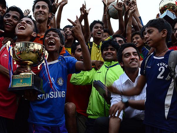 I am teaching football to create a safer society through sports